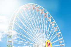 Ferris wheel against the blue sky toned photo Stock Photography