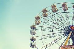 Ferris wheel against blue sky Stock Image
