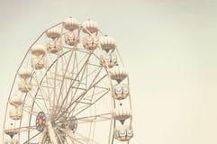 Ferris wheel against blue sky Stock Images