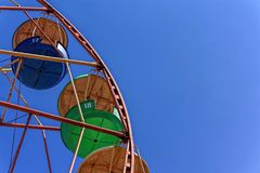 Ferris wheel against the blue sky royalty free stock photo
