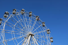 Ferris wheel against bright blue sky Stock Photos