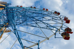 Ferris wheel. Against a cloudy sky background Stock Photo