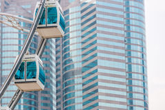 Ferris wheel against commercial building. Hong Kong royalty free stock photography