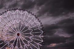 Ferris wheel against the dark sky Stock Images