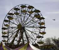 Ferris wheel with airplane on the background Royalty Free Stock Image