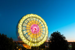 The Ferris wheel, amusement, on the background of blue sky Stock Image