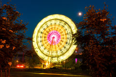 The Ferris wheel, amusement, on the background of blue sky Stock Images