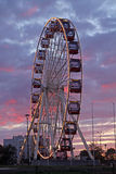 Ferris wheel at amusement park Stock Images