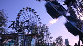 Ferris wheel at the amusement Park in action. HELSINKI, FINLAND - JUNE 07, 2016: Ferris wheel at the amusement Park in action. Summertime stock video footage