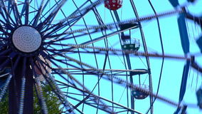 Ferris wheel at the amusement Park in action. Summertime stock video