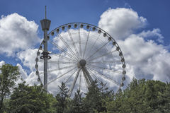 Ferris wheel in the amusement park with blue sky at the background Royalty Free Stock Images