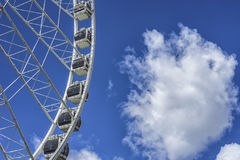 Ferris wheel in the amusement park with blue sky at the background Stock Photo
