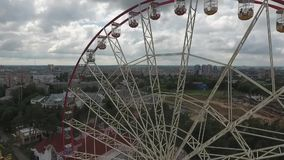 Ferris wheel in amusement park in the downtown stock footage