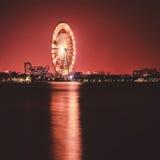 Ferris wheel amusement park at night, long exposure photography Stock Photo