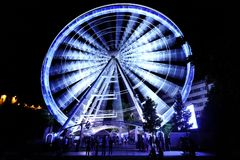 Ferris wheel at amusement park at night Royalty Free Stock Photo