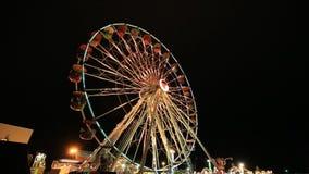 Ferris Wheel at amusement park at a night stock video