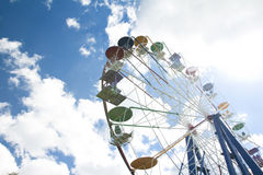 Ferris wheel in an amusement park. On sky background Stock Photography