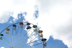 Ferris wheel in an amusement park. On sky background Royalty Free Stock Photo