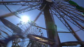 Ferris wheel in an amusement Park with sunlight in action. Ferris wheel in an amusement Park with sunlight in action stock video footage