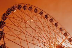 Ferris wheel in the amusement Park, tinted stock photography