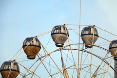 Ferris wheel at amusement park under blue sky Stock Images