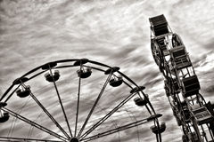 Ferris Wheel and Amusement Ride at Fair Fairground Royalty Free Stock Image