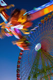 Ferris Wheel And Carnival Ride Stock Image