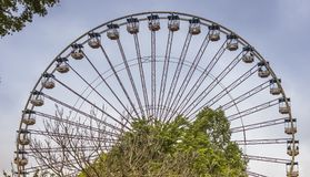 Ferris wheel in atraction park. BIDDIGHUIZEN,HOLLAND,25-03-2013:Unidentified people having fun in ferris wheel in biddinghuizen city has a big park called walibi Stock Image
