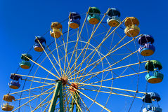 Ferris wheel. Attraction ferris wheel against the clear blue sky Royalty Free Stock Images