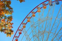 Ferris wheel and autumn foliage Stock Photography