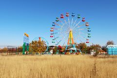 Ferris wheel in autumn park royalty free stock image