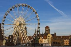Ferris wheel on the background of the beautiful city of Gdansk. Poland royalty free stock image