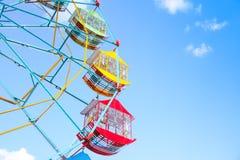 Ferris wheel on the background of blue sky. Colourful Vintage Ferris wheel royalty free stock photos