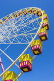 Ferris wheel on the background of blue sky. During daytime Stock Images
