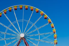 Ferris wheel on the background of blue sky. During daytime Royalty Free Stock Photography
