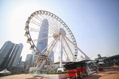 Ferris wheel on a background of blue sky and skyscrapers. Skyline. Stock Photo