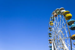 Ferris wheel on the background of clear blue sky. Horizontal shot, background Stock Photo