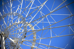 Ferris wheel on the background of clear blue sky. Horizontal shot, background Royalty Free Stock Images