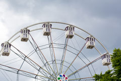Ferris wheel on a background cloudy sky Royalty Free Stock Image