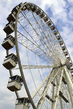 Ferris wheel on a background of the cloudy sky Royalty Free Stock Photo