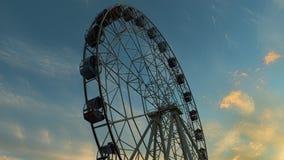 Ferris wheel at sunset. Time lapse stock video