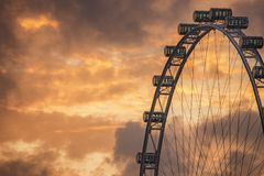 Ferris Wheel on the background of evening sky Stock Image