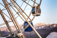 Ferris wheel on a background of mountains, close-up stock images