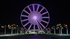 A Ferris Wheel in Baku on the shore of the Caspian Sea, at night with lights. Ferris wheel on the boulevard in Baku, near the Caspian Sea, shot in the evening on stock footage