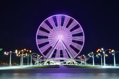 A Ferris Wheel in Baku on the shore of the Caspian Sea, at night with lights. Ferris wheel on the boulevard in Baku, near the Caspian Sea, shot in the evening on stock photo