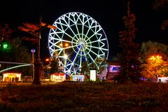 Ferris wheel on the banks of the Amur river in Khabarovsk. Russia. stock photos