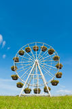 Ferris wheel with basket of flowers Royalty Free Stock Photos