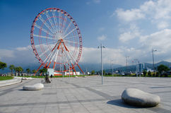 Ferris wheel on Batumi seafront with Caucasus mountains,Georgia Stock Image