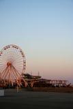 Ferris Wheel on Beach. Tall ferris wheel on beach boardwalk with sunset Royalty Free Stock Photo