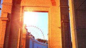 Ferris wheel behind the wall is seen in large stock video footage